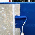既存コンクリートの巣穴をパテで埋めして塗装